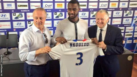 Cameroon's Nicolas Nkoulou with his new Lyon shirt