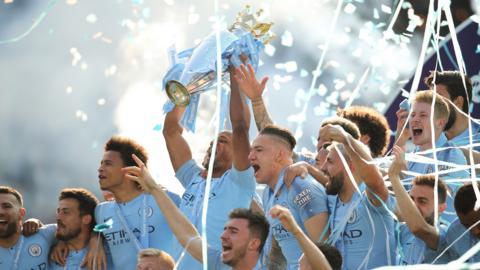 Man City's Vincent Kompany lifts the Premier League trophy