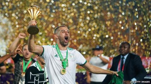 Islam Slimani holds aloft the Africa Cup of Nations trophy