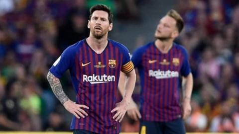 Lionel Messi (left)