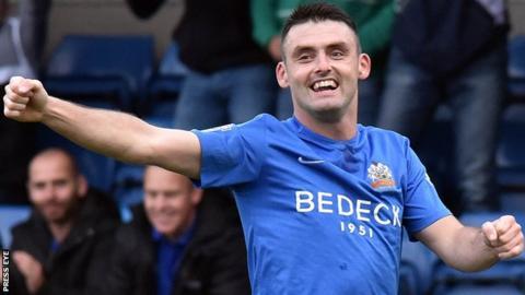 Eoin Bradley celebrates scoring one of his 40 goals for the Lurgan Blues