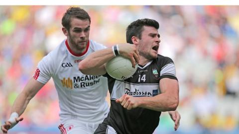 Tyrone's Ronan McNamee keeps tabs on Pat Hughes of Sligo during the All-Ireland qualifier tie on Saturday