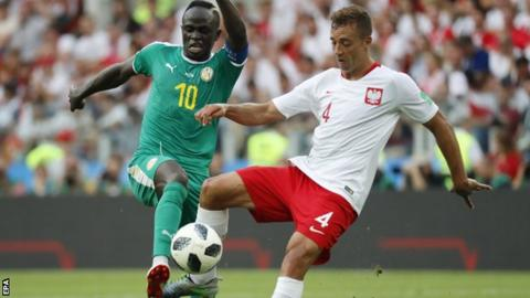 Japan rallies to tie Senegal at World Cup