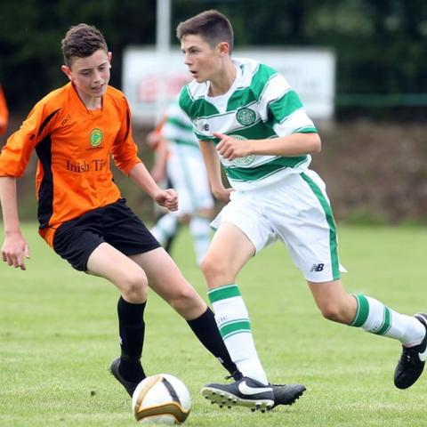 Pearse McCarron of the Inishowen League competes against Celtic's Ruaridh McIntyre