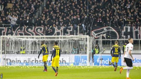 Fans flood pitch with tennis balls in Bundesliga Monday night protest