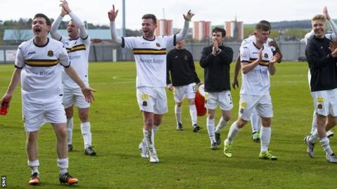 Dumbarton celebrate securing their Championship status
