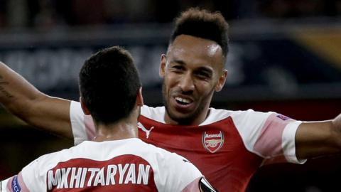 Pierre-Emerick Aubameyang celebrates with Henrikh Mkhitaryan