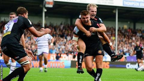 Exeter celebrate their fourth try