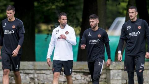 Dundee United's Benjamin Siegrist, goalkeeping coach Neil Alexander, Josh Donaldson, and Matej Rakovan