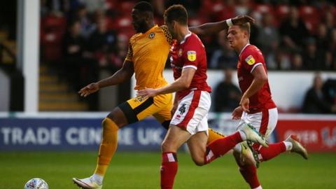 Jamille Matt of Newport County takes a shot at goal against Walsall