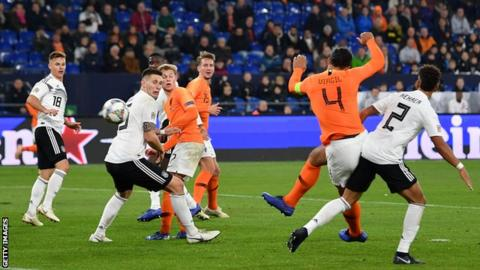 Virgil van Dijk consoles referee Ovidiu Hategan after Netherlands match