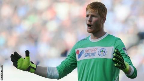 Adam Bogdan in action for Wigan Athletic