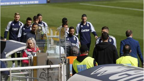 Players await news on the pitch
