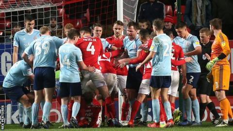 Charlton and Accrington players clash