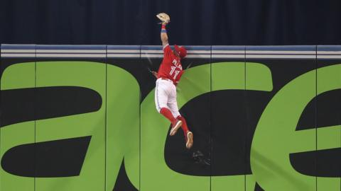 TORONTO, ON - JULY 1: Kevin Pillar #11 of the Toronto Blue Jays climbs the wall and catches a fly ball hit by Nicholas Castellanos #9 of the Detroit Tigers in the ninth inning during MLB game action at Rogers Centre on July 1, 2018 in Toronto, Canada. (Photo by Tom Szczerbowski/Getty Images)