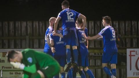 Agony for Carrick keeper Harry Doherty as the Mallards celebrate their second goal