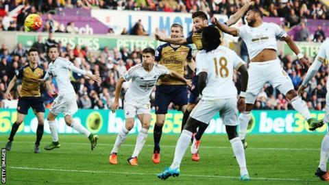 Olivier Giroud scores Arsenal's first goal against Swansea