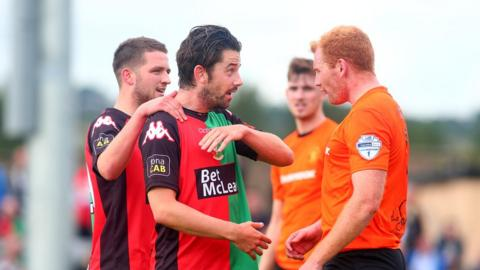 Glentoran striker Curtis Allen was booked following a confrontation with Carrick's Joe McNeill late in the game at Taylor's Avenue
