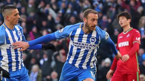 Glenn Murray celebrates one of his two goals for Brighton