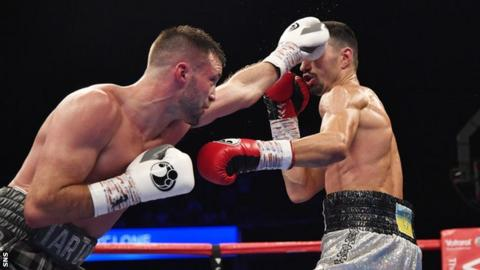 Josh Taylor unleashes a jab against Viktor Postol