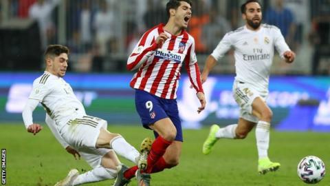 Federico Valverde tackles Alvaro Morata