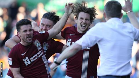 Ash Taylor celebrates a goal for Northampton