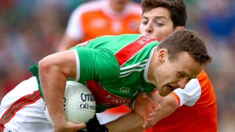 Mayo forward Andy Moran is halted by Armagh's Paddy Burns at McHale Park