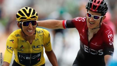 Egan Bernal and Geraint Thomas celebrate as they approach the finishing line at the end of Saturday's penultimate stage of the 2029 Tour de France