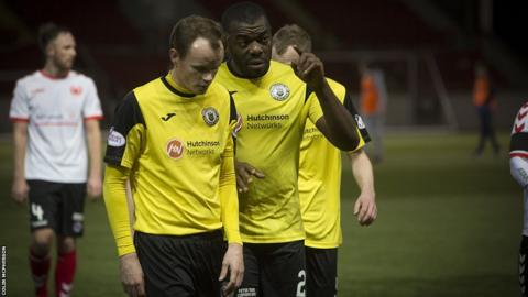 City's Joe Mbu and Ross Guthrie (left) leaving the pitch at full-time.