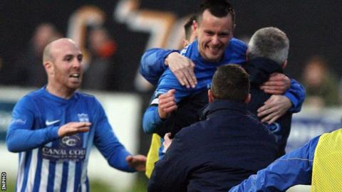 Mark Hughes celebrates scoring Newry's third goal in the victory over Carrick on Wednesday night