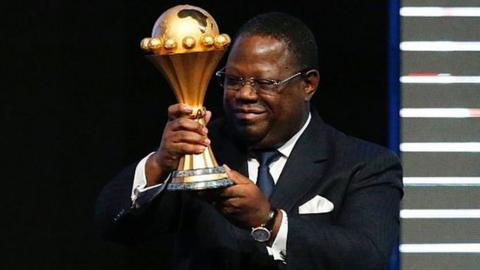 Gabonese Prime Minister Emmanuel Issoze Ngondet with the Nations Cup trophy