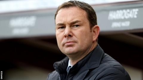 Derek Adams watches his Plymouth side from the touchline