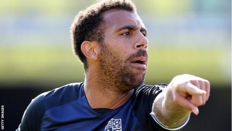 Anton Ferdinand gestures towards his Southend team-mates