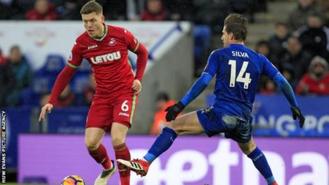 Alfie Mawson in action against Leicester