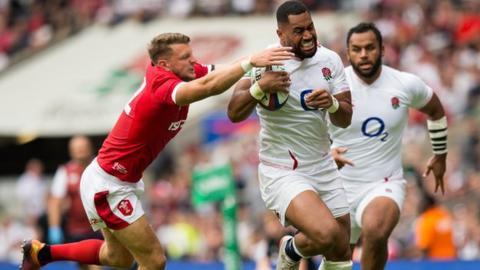 Liam Williams Wales Dan Biggar tries to stop England's Joe Cokanasiga