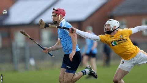 Dublin's Danny Sutcliffe is put under pressure by Neil McManus in the Corrigan Park encounter