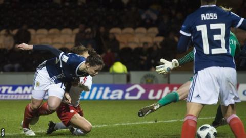 Scotland's Zoe Ness stoops to score against Poland
