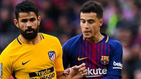Barcelona's Philippe Coutinho battles with Atletico Madrid's Diego Costa