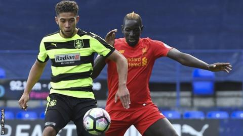 Rekeil Pyke in action for Huddersfield Town against Mamadou Sakho of Liverpool in the Premier League Cup