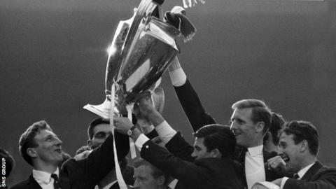 Celtic players show off the European Cup on their return to Glasgow