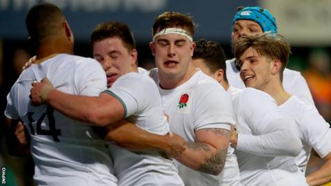 Henry Walker is congratulated by England team-mates after scoring his side's second try