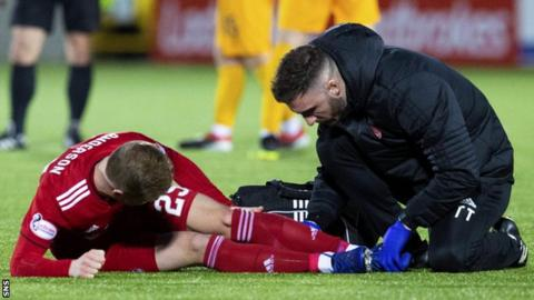 Aberdeen's Bruce Anderson receives treatment against Livingston