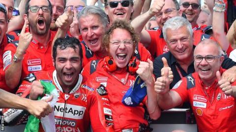 Danilo Petrucci celebrates winning the Italian GP with his Ducati team