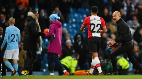 Manchester City manager Pep Guardiola confronts Southampton's Nathan Redmond