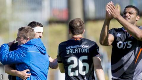 Kilmarnock manager Lee Clark congratulates his players