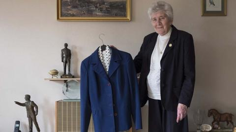 Pat Godbold with the blue suit she wore at Wembley