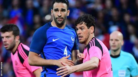 Adil Rami of France is marked by Scotalnd's Gordon Greer