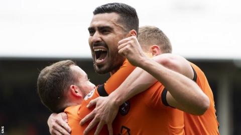 Rachid Bouhenna celebrates with Dundee United