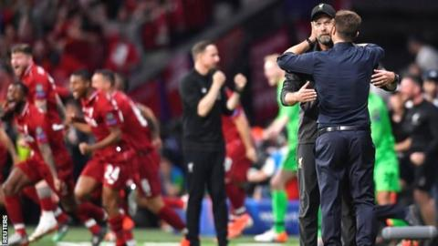 Liverpool manager Jurgen Klopp and Tottenham manager Mauricio Pochettino embrace after the Champions League final