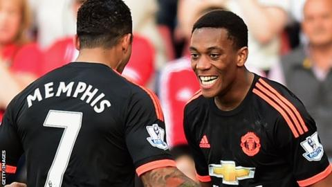 Anthony Martial celebrates with Memphis Depay